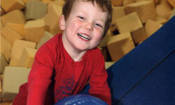 KinderGym - smiling child in foam pit